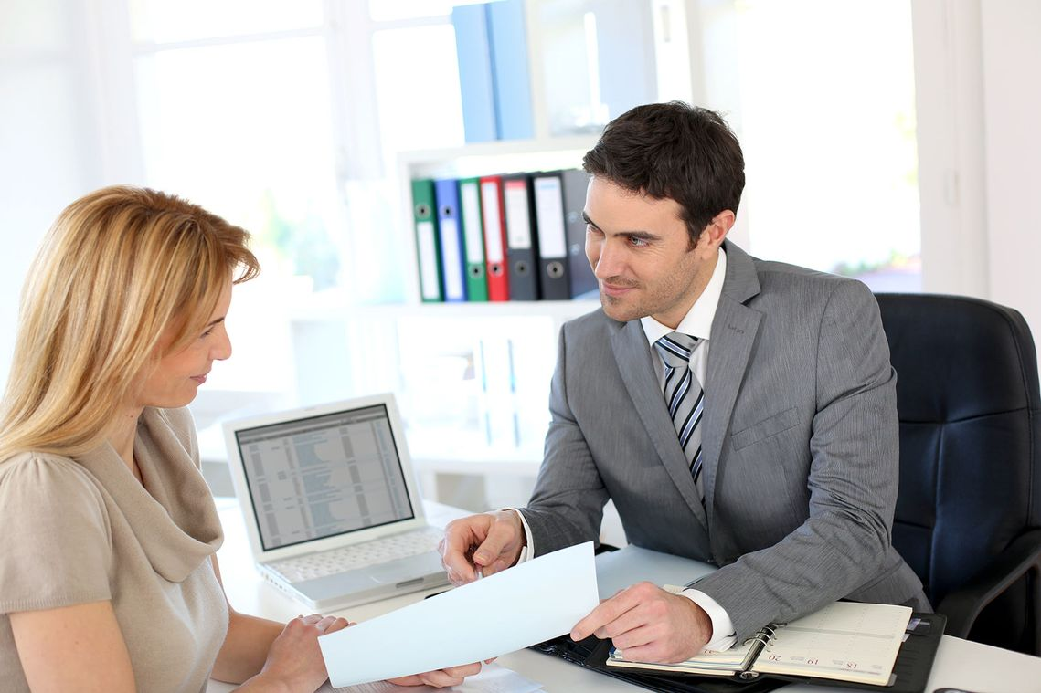 a woman having a meeting with a divorce lawyer
